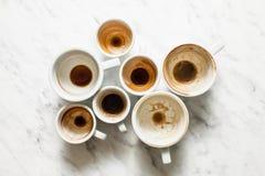 Βρώμικα φλιτζάνια του καφέ afterparty Στοκ Εικόνα