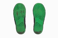Βρώμικα χρησιμοποιημένα πράσινα πέλματα παπουτσιών Στοκ Εικόνα