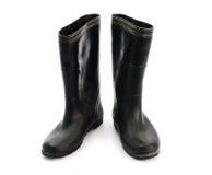 Βρώμικες μαύρες λαστιχένιες μπότες που απομονώνονται στο άσπρο υπόβαθρο Στοκ εικόνες με δικαίωμα ελεύθερης χρήσης