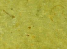 Βρώμικη κίτρινη υφαντική επιφάνεια με τα διαφορετικά σημεία Στοκ φωτογραφία με δικαίωμα ελεύθερης χρήσης