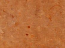 Βρώμικη πορτοκαλιά υφαντική επιφάνεια με τα διαφορετικά σημεία Στοκ Εικόνες