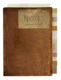 Βρώμικο παλαιό σημειωματάριο με τις ετικέττες Στοκ φωτογραφία με δικαίωμα ελεύθερης χρήσης