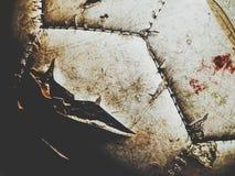Βρώμικο ποδόσφαιρο με τα ίχνη αίματος Στοκ Εικόνες