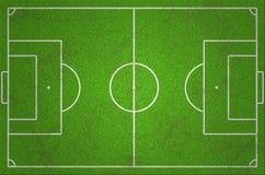 Βρώμικο πράσινο γήπεδο ποδοσφαίρου Στοκ Φωτογραφίες