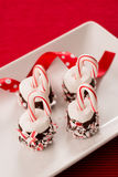 Βυθισμένα σοκολάτα Marshmallows με τους καλάμους καραμελών Στοκ Εικόνες