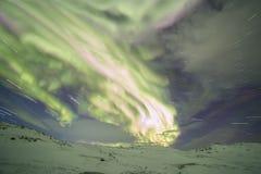 Βόρεια φω'τα στη χερσόνησο κόλα Teriberka, Μούρμανσκ Regio Στοκ Φωτογραφία