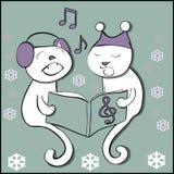 Γάτες τραγουδιού με snowflakes Στοκ Φωτογραφία