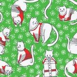 Γάτες Χριστουγέννων στο πλεκτό άνευ ραφής διανυσματικό σχέδιο πουλόβερ απεικόνιση αποθεμάτων