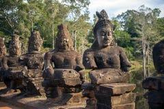 Γίγαντες σε Angkor Thom Στοκ Εικόνες