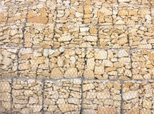 γίνοντα ανασκόπηση λευκό τοίχων σύστασης πετρών πετρών Υπόβαθρο τοίχων βράχου Στοκ Εικόνες