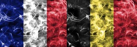Γαλλία εναντίον της σημαίας καπνού του Βελγίου Στοκ εικόνα με δικαίωμα ελεύθερης χρήσης