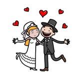 Γαμήλιο ζευγάρι ακριβώς παντρεμένο με τα σύμβολα αγάπης Στοκ Φωτογραφίες