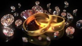 Γαμήλια δαχτυλίδια και διαμάντια ελεύθερη απεικόνιση δικαιώματος