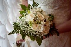 Γαμήλια νυφική ανθοδέσμη με τα δαχτυλίδια Στοκ Εικόνα
