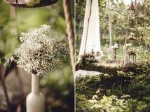 Γαμήλιο ντεκόρ με τα λουλούδια και τα κεριά στο δάσος Στοκ Εικόνα