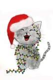 Γατάκι που μπλέκεται στα φω'τα Χριστουγέννων Στοκ Εικόνες