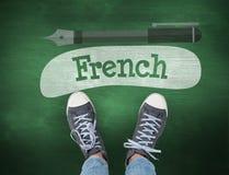 Γαλλικά ενάντια στον πράσινο πίνακα κιμωλίας Στοκ Εικόνα