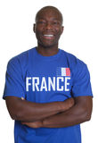 Γαλλικός αθλητικός ανεμιστήρας με τα διασχισμένα όπλα Στοκ εικόνα με δικαίωμα ελεύθερης χρήσης