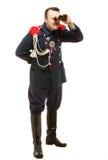 Γαλλικός γενικός με το όμορφο mustache που κοιτάζει μέσω διοφθαλμικού Στοκ εικόνα με δικαίωμα ελεύθερης χρήσης