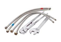 Γαλλικό κλειδί υδραυλικών, διευθετήσιμο γαλλικό κλειδί και διάφορες μάνικες με το braidin Στοκ φωτογραφίες με δικαίωμα ελεύθερης χρήσης