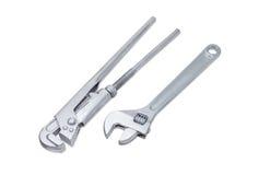 Γαλλικό κλειδί υδραυλικών και διευθετήσιμο γαλλικό κλειδί σε ένα ελαφρύ υπόβαθρο Στοκ φωτογραφία με δικαίωμα ελεύθερης χρήσης