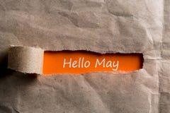 Γειά σου έννοια Μαΐου Επιγραφή στο σχισμένο φάκελο 1 Μαΐου - Εργατική Ημέρα Στοκ φωτογραφία με δικαίωμα ελεύθερης χρήσης