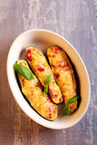 Γεμισμένα κολοκύθια με τα λαχανικά και το λειωμένο τυρί Στοκ Εικόνες