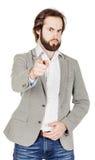 Γενειοφόρο άτομο που δείχνει το δάχτυλό του ενάντια σε κάποιο ανθρώπινη συγκίνηση, Στοκ φωτογραφίες με δικαίωμα ελεύθερης χρήσης