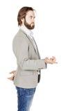 Γενειοφόρο άτομο που δείχνει το δάχτυλό του ενάντια σε κάποιο ανθρώπινη συγκίνηση, Στοκ Εικόνες