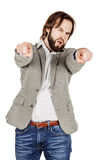 Γενειοφόρο άτομο που δείχνει το δάχτυλό του ενάντια σε κάποιο ανθρώπινη συγκίνηση, Στοκ φωτογραφία με δικαίωμα ελεύθερης χρήσης