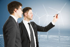 Γεννήτριες αέρα χρωμάτων επιχειρηματιών στον τοίχο με την επιχειρησιακή ισοτιμία Στοκ Φωτογραφίες
