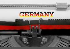 Γερμανία με το εθνικό κείμενο σημαιών χρωμάτων Στοκ εικόνες με δικαίωμα ελεύθερης χρήσης