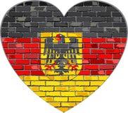Γερμανική σημαία σε έναν τουβλότοιχο στη μορφή καρδιών απεικόνιση αποθεμάτων