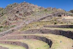 Γεωργικές πεζούλια Inca και του χωριού καταστροφές σε Pisaq, Περού στοκ εικόνα