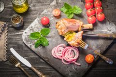 Γεύμα κνημών αρνιών Στοκ Εικόνες