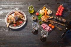Γεύμα κνημών αρνιών στοκ εικόνα με δικαίωμα ελεύθερης χρήσης