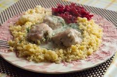 Γεύμα με τις σφαίρες και grits κρέατος Στοκ Εικόνες