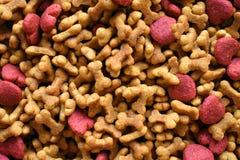 Γεύση κρέατος τροφίμων σκυλιών, κόκκαλο και μορφή καρδιών Στοκ Φωτογραφίες