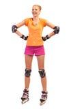 Γελώντας γυναίκα στα rollerblades. Στοκ Φωτογραφίες