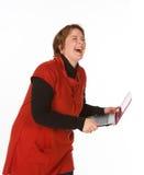 Γελώντας καυκάσια γυναίκα στο πορτοκάλι Στοκ Φωτογραφίες