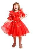 Γελώντας κορίτσι που φορά το φόρεμα διακοπών Στοκ Φωτογραφία