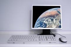 γη υπολογιστών γραφείο&ups Στοκ Εικόνες