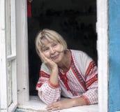 Γιαγιά στο παράθυρο Στοκ Εικόνα