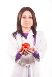 γιατρός μήλων που παρουσιάζει το κόκκινο Στοκ Φωτογραφία