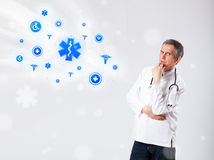 Γιατρός με τα μπλε ιατρικά εικονίδια Στοκ Φωτογραφίες