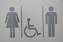 Για άνδρες και για γυναίκες σημάδι λουτρών αναπηρίας Στοκ Εικόνες