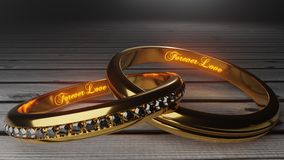 Για πάντα αγάπη - τα χρυσά γαμήλια δαχτυλίδια ένωσαν μαζί για πάντα με χαραγμένος και να φορέσουν γάντια λέξεις που συμβολίζουν τ απεικόνιση αποθεμάτων