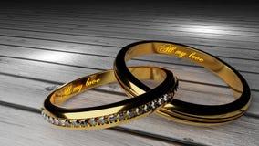 Για πάντα αγάπη - τα χρυσά γαμήλια δαχτυλίδια ένωσαν μαζί για πάντα με χαραγμένος και να φορέσουν γάντια λέξεις απεικόνιση αποθεμάτων