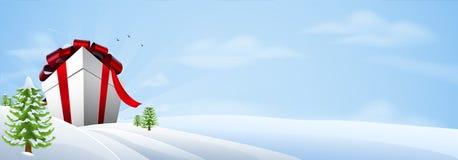 γιγαντιαίο δώρο Χριστουγέννων εμβλημάτων ανασκόπησης Στοκ φωτογραφία με δικαίωμα ελεύθερης χρήσης