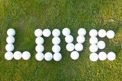 Γκολφ αγάπης - αγάπη στις σφαίρες γκολφ Στοκ Εικόνα